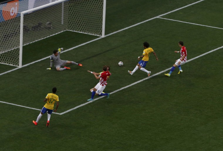 Brazil's Marcelo (2nd R) scores an own goal during the 2014 World Cup opening match between Brazil and Croatia at the Corinthians arena in Sao Paulo June 12, 2014. (Paulo Whitaker/Reuters)