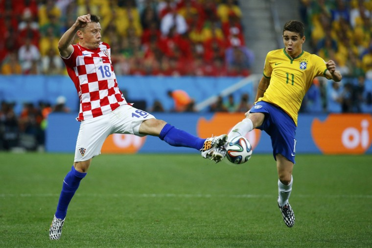 Croatia's Ivica Olic fights for the ball with Brazil's Oscar during their 2014 World Cup opening match at the Corinthians arena in Sao Paulo June 12, 2014. (Kai Pfaffenbach/Reuters)