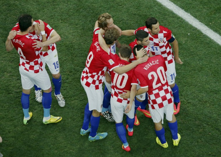 Croatia's players celebrate an own goal by Brazil's Marcelo during their 2014 World Cup opening match at the Corinthians arena in Sao Paulo June 12, 2014. (Fabrizio Bensch/Reuters)