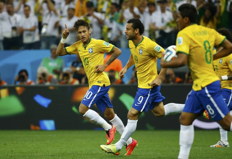 Brazil's Neymar (L) celebrates, with teammates Fred (C) and Paulinho, after scoring a goal against Croatia during their 2014 World Cup opening match at the Corinthians arena in Sao Paulo June 12, 2014. (Kai Pfaffenbach/Reuters)