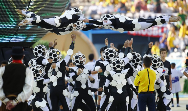 Performers dance during the opening ceremony of the 2014 World Cup at the Corinthians arena in Sao Paulo June 12, 2014. (Kai Pfaffenbach/Reuters)