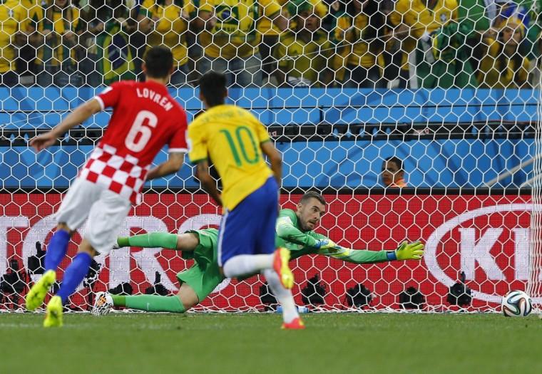 Croatia's Dejan Lovren (L) and Stipe Pletikosa (R) react as Brazil's Neymar scores a goal during the 2014 World Cup opening match between Brazil and Croatia at the Corinthians arena in Sao Paulo June 12, 2014. (Ivan Alvarado/Reuters)