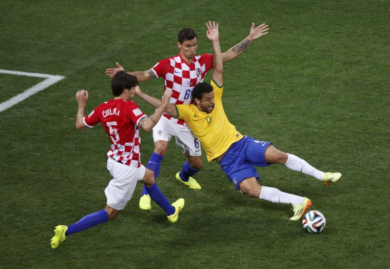 Brazil's Fred is fouled by Croatia's Dejan Lovren inside the area during their 2014 World Cup opening match at the Corinthians arena in Sao Paulo June 12, 2014. (Paulo Whitaker/Reuters)