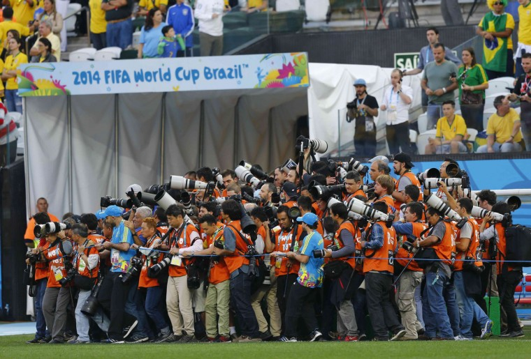 Photographers struggle to get to their positions ahead of the 2014 World Cup opening match between Brazil and Croatia at the Corinthians arena in Sao Paulo June 12, 2014. (Ivan Alvarado/Reuters)