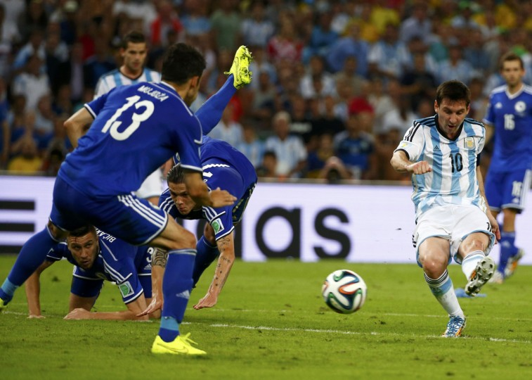 Argentina's Lionel Messi (R) scores a goal during the 2014 World Cup Group F soccer match against Bosnia and Herzegovina at the Maracana stadium in Rio de Janeiro June 15, 2014. (Michael Dalder/Reuters)