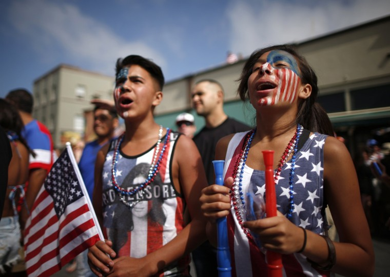 Michelle Lopez, 14, (R) and her brother Erick Lopez, 12, watch the 2014 Brazil World Cup Group G soccer match between Ghana and the U.S. at a viewing party in Hermosa Beach, California. (Lucy Nicholson/Reuters photo)