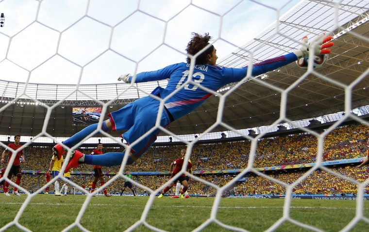 Mexico's goalkeeper Guillermo Ochoa makes a save on a shot by Brazil's Neymar (not seen) during their 2014 World Cup Group A soccer match at the Castelao arena in Fortaleza June 17, 2014. (Kai Pfaffenbach/Reuters)