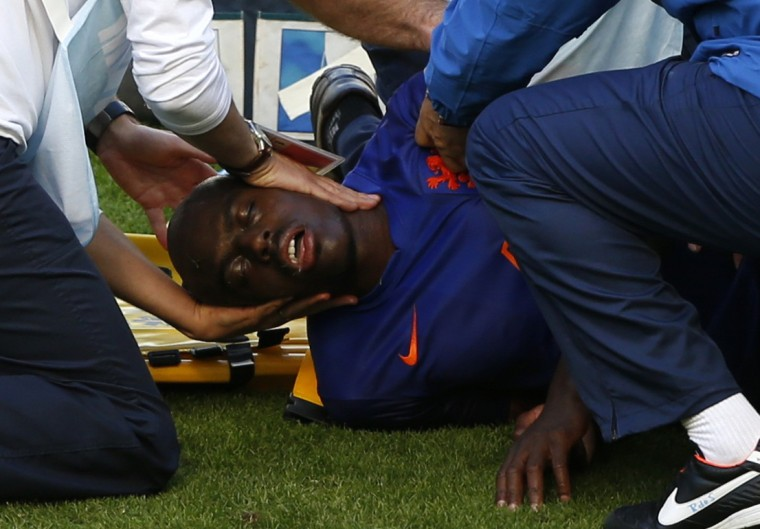 Bruno Martins Indi of the Netherlands is placed on a stretcher after being fouled by Australia's Tim Cahill (unseen) during their 2014 World Cup Group B soccer match at the Beira Rio stadium in Porto Alegre June 18, 2014. (Marko Djurica/Reuters)