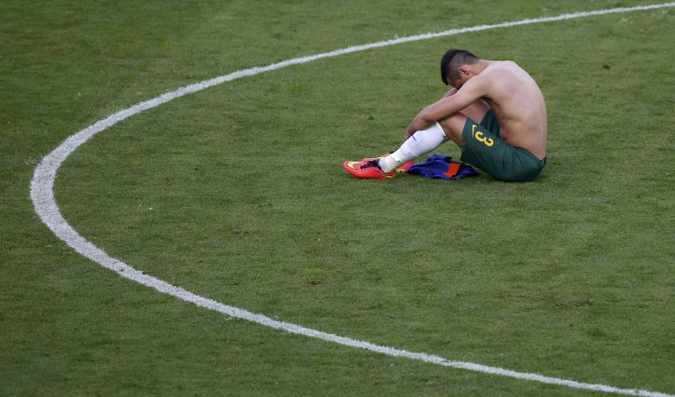 Australia's Jason Davidson reacts at the end of their 2014 World Cup Group B soccer match against Netherlands at the Beira Rio stadium in Porto Alegre June 18, 2014. (Marko Djurica/Reuters)