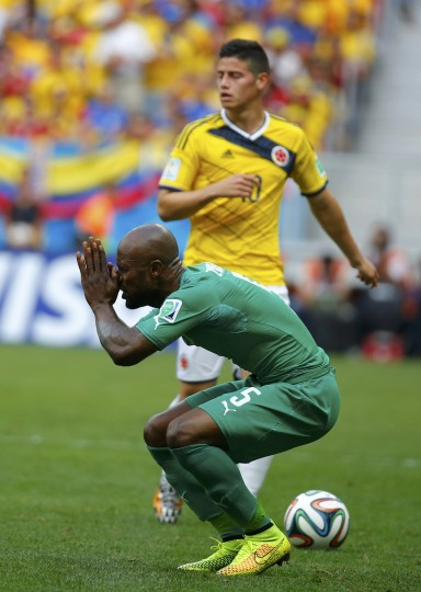 Ivory Coast's Didier Zokora (front) reacts after his foul on Colombia's Juan Cuadrado (unseen) during their 2014 World Cup Group C soccer match at the Brasilia national stadium in Brasilia June 19, 2014. Zokora was given the yellow card for the foul. (Paul Hanna/Reuters)