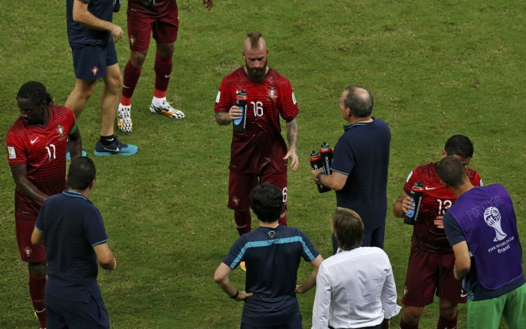 Portugal's Nani (L), Raul Meireles (C) and Ricardo Costa (2nd R) take a water break during their 2014 World Cup G soccer match against the U.S. at the Amazonia arena in Manaus June 22, 2014. (Andres Stapff/Reuters)