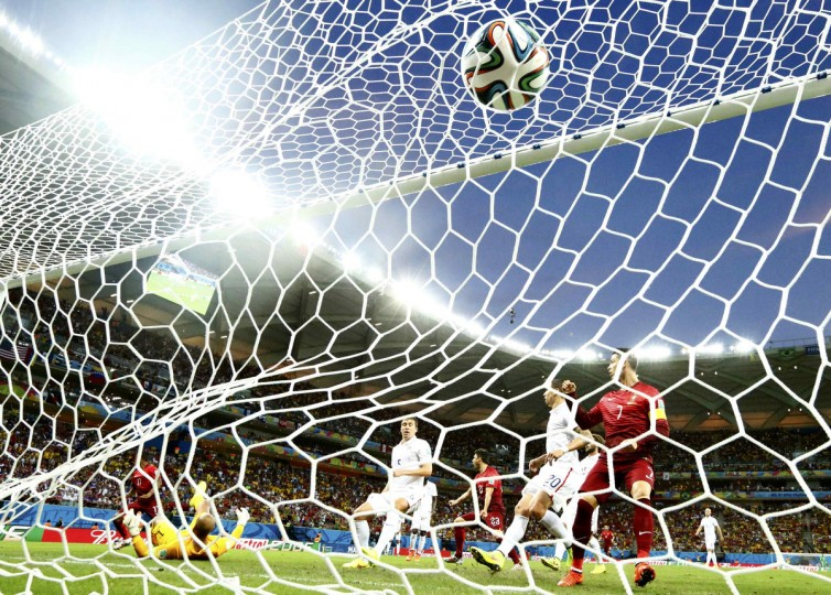 Portugal's Cristiano Ronaldo watches Portugal's Nani score a goal during the 2014 World Cup G soccer match between Portugal and the U.S. at the Amazonia arena in Manaus June 22, 2014. (Siphiwe Sibeko/Reuters)