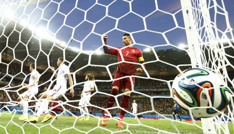 Portugal's Cristiano Ronaldo (R) celebrates a goal against the U.S. by teammate Nani (unseen) during their 2014 World Cup Group G soccer match at the Amazonia arena in Manaus June 22, 2014. (Siphiwe Sibeko/Reuters)