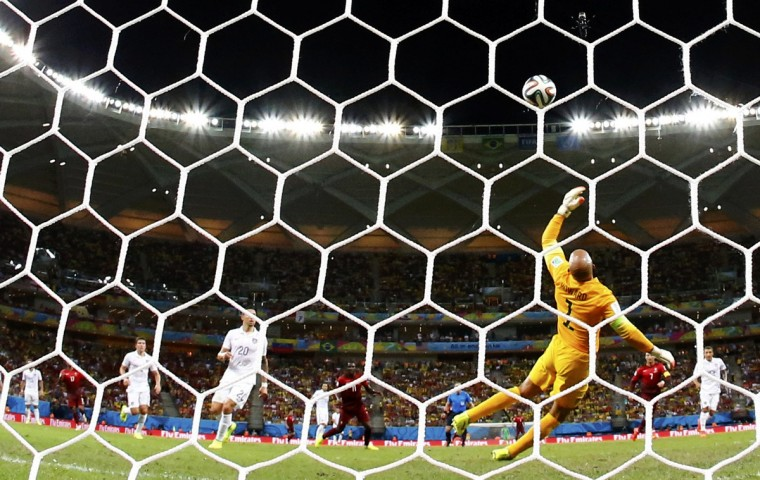 Goalkeeper Tim Howard of the U.S. saves a shot from Portugal's Eder during their 2014 World Cup G soccer match at the Amazonia arena in Manaus June 22, 2014. (Siphiwe Sibeko/Reuters)