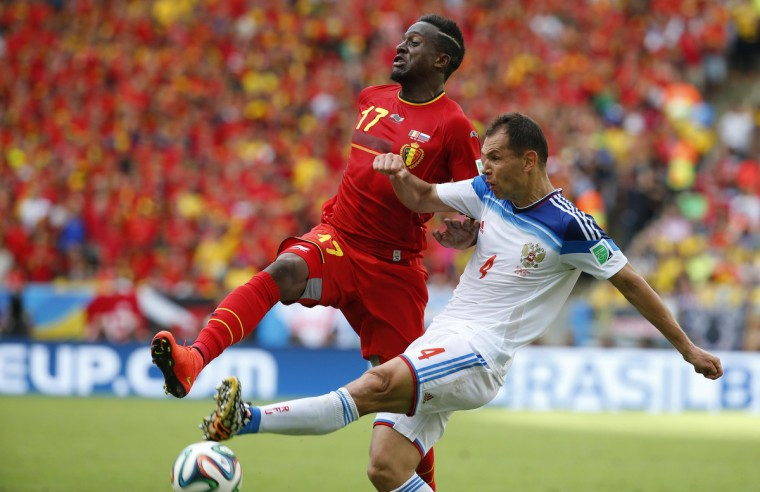 Belgium's Divock Origi (L) fights for the ball with Russia's Sergey Ignashevich during their 2014 World Cup Group H soccer match at the Maracana stadium in Rio de Janeiro June 22, 2014. (Yves Herman/Reuters)