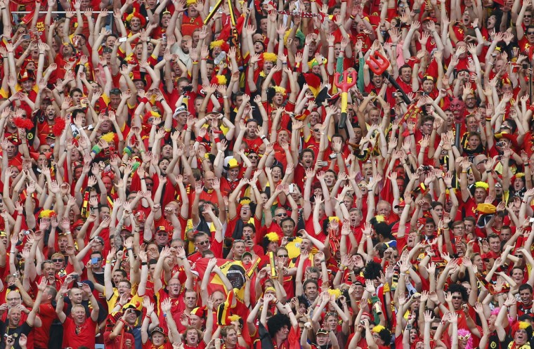Belgian fans wave during their 2014 World Cup Group H soccer match against Russia at the Maracana stadium in Rio de Janeiro June 22, 2014. (Yves Herman/Reuters)