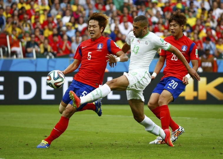 Algeria's Islam Slimani (C) kicks to score a goal next to South Korea's Kim Young-gwon (L) and Hong Jeong-ho during their 2014 World Cup Group H soccer match at the Beira Rio stadium in Porto Alegre June 22, 2014. (Murad Sezer/Reuters)