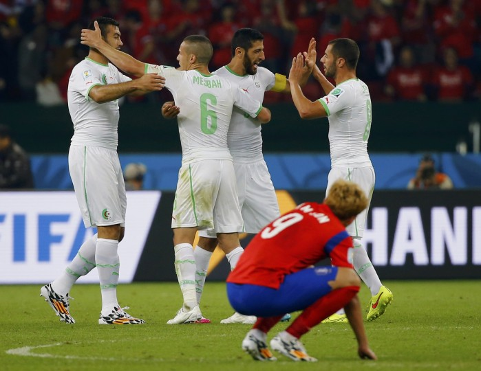 South Korea's Son Heung-min (front) reacts as Algeria's players celebrate their win at the end of their 2014 World Cup Group H soccer match at the Beira Rio stadium in Porto Alegre June 22, 2014. (Damir Sagolj/Reuters)