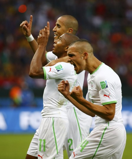 Algeria's Yacine Brahimi (11) celebrates with Nabil Bentaleb (14) and Madjid Bougherra after scoring a goal during the 2014 World Cup Group H soccer match between South Korea and Algeria at the Beira Rio stadium in Porto Alegre June 22, 2014. (Damir Sagolj/Reuters)