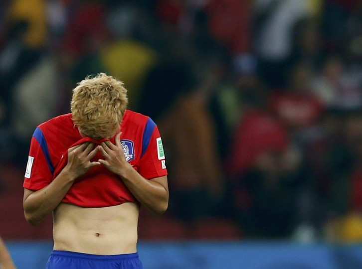 South Korea's Son Heung-min reacts after their loss to Algeria in their 2014 World Cup Group H soccer match at the Beira Rio stadium in Porto Alegre June 22, 2014. (Edgard Garrido/Reuters)