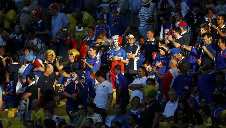 Fans are illuminated by a ray of sunlight on the stands before the 2014 World Cup Group E soccer match between France and Ecuador at the Maracana stadium in Rio de Janeiro June 25, 2014. (Kai Pfaffenbach/Reuters)