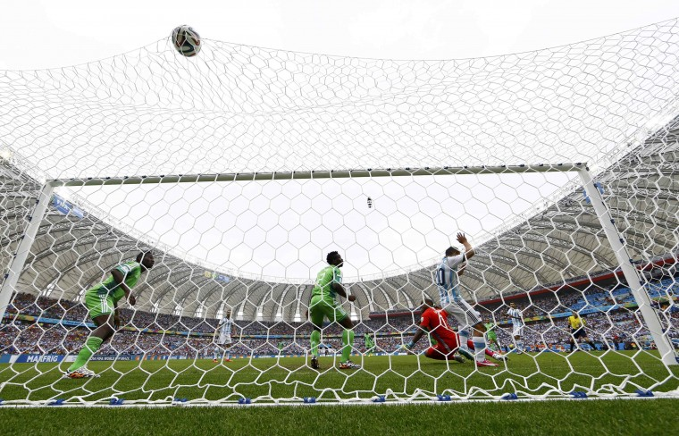 Argentina's Lionel Messi scores a goal against Nigeria during their 2014 World Cup Group F soccer match at the Beira Rio stadium in Porto Alegre June 25, 2014. (Darren Staples/Reuters)
