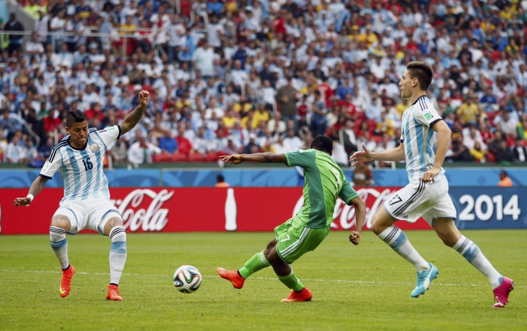Nigeria's Ahmed Musa (C) shoots to score against Argentina during their 2014 World Cup Group F soccer match at the Beira Rio stadium in Porto Alegre June 25, 2014. (Darren Staples/Reuters)