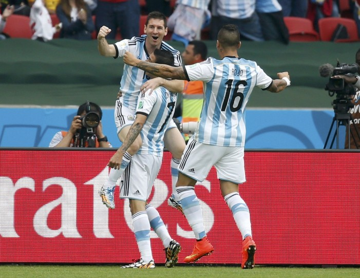 Argentina's Lionel Messi celebrates scoring a goal with teammates Marcos Rojo (R) and Angel Di Maria during the 2014 World Cup Group F soccer match against Nigeria at the Beira Rio stadium in Porto Alegre June 25, 2014. (Edgard Garrido/Reuters)