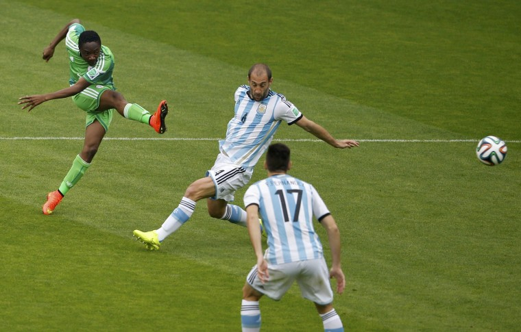 Nigeria's Ahmed Musa (L) scores a goal past Argentina's Pablo Zabaleta and Federico Fernandez during their 2014 World Cup Group F soccer match at the Beira Rio stadium in Porto Alegre June 25, 2014. (Marko Djurica/Reuters)