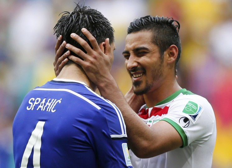 Iran's Reza Ghoochannejhad (R) talks to Bosnia's Emir Spahic at the end of their 2014 World Cup Group F soccer match at the Fonte Nova arena in Salvador June 25, 2014. (Marcos Brindicci/Reuters)