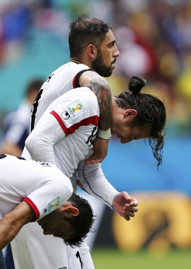 Iran's Pejman Montazeri (L-R), Andranik Teymourian and Ashkan Dejagah react after being defeated by Bosnia in their 2014 World Cup Group F soccer match at the Fonte Nova arena in Salvador June 25, 2014. (Marcos Brindicci/Reuters)
