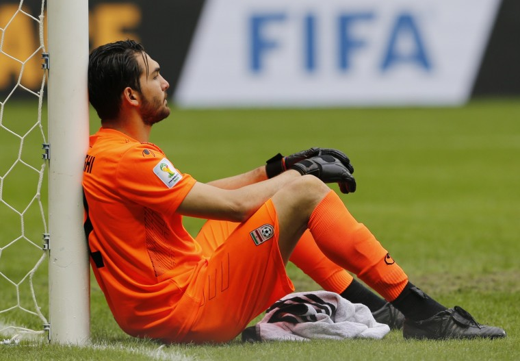 Iran's Alireza Haghighi reacts after the match against Bosnia during their 2014 World Cup Group F soccer match at the Fonte Nova arena in Salvador June 25, 2014. (Sergio Perez/Reuters)