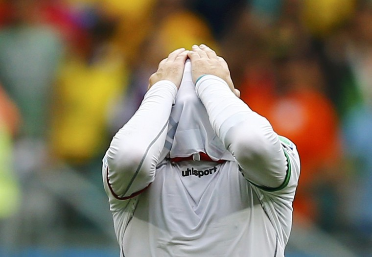 Iran's Andranik Teymourian reacts after being defeated by Bosnia in their 2014 World Cup Group F soccer match at the Fonte Nova arena in Salvador June 25, 2014. (Ivan Alvarado/Reuters)