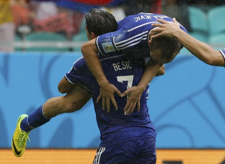 Bosnia's Muhamed Besic carries teammate Avdija Vrsajevic in celebration after Vrsajevic scored a goal against Iran during their 2014 World Cup Group F soccer match at the Fonte Nova arena in Salvador June 25, 2014. (Sergio Perez/Reuters)