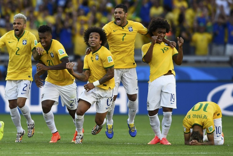 Brazil's national soccer players celebrate Chile's decisive miss during a penalty shootout in their 2014 World Cup round of 16 game at the Mineirao stadium in Belo Horizonte June 28, 2014. Also pictured are (L-R) Brazil's Dani Alves, Jo,Marcelo, Hulk and Willian. (Dylan Martinez/Reuters)