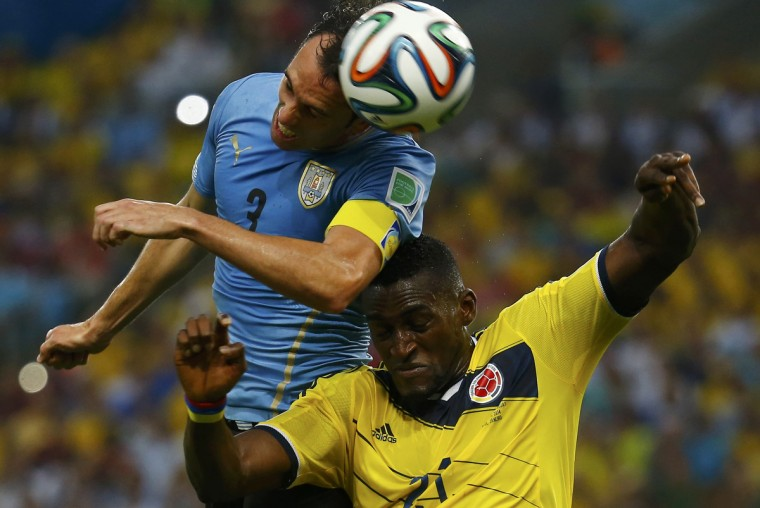 Uruguay's Diego Godin (L) fights to head the ball with Colombia's Jackson Martinez during their 2014 World Cup round of 16 game at the Maracana stadium in Rio de Janeiro June 28, 2014. (Kai Pfaffenbach/Reuters)