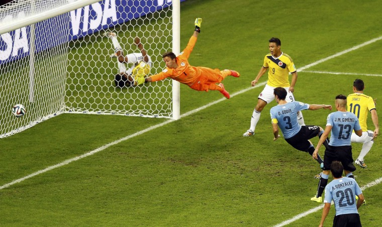 Uruguay's goalkeeper Fernando Muslera (2nd L) fails to save a goal scored by Colombia's James Rodriguez (R), his second goal, during their 2014 World Cup round of 16 game at the Maracana stadium in Rio de Janeiro June 28, 2014. (Ricardo Moraes/Reuters)