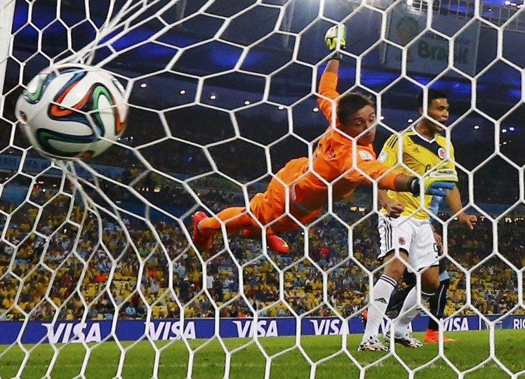 Uruguay's goalkeeper Fernando Muslera (C) concedes a second goal scored by Colombia's James Rodriguez (not pictured) during their 2014 World Cup round of 16 game at the Maracana stadium in Rio de Janeiro June 28, 2014. (Michael Dalder/Reuters)