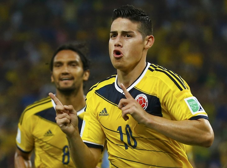Colombia's James Rodriguez celebrates his goal against Uruguay infront of teammate Abel Aguilar during their 2014 World Cup round of 16 game at the Maracana stadium in Rio de Janeiro June 28, 2014. (Kai Pfaffenbach/Reuters)