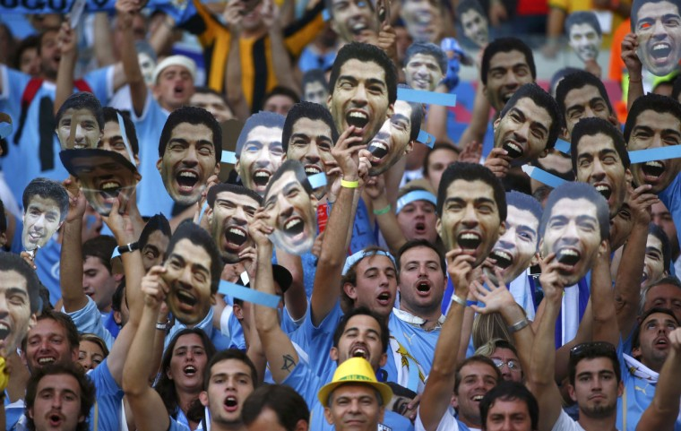 Uruguay fans hold up pictures of Luis Suarez before the 2014 World Cup round of 16 game between Colombia and Uruguay at the Maracana stadium in Rio de Janeiro June 28, 2014. (Michael Dalder/Reuters)