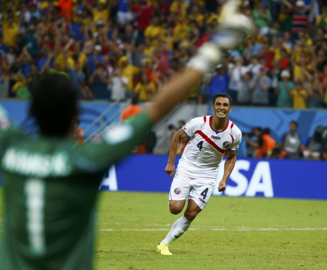 Costa Rica's Michael Umana celebrates with goalkeeper Keilor Navas after scoring the decisive penalty during a penalty shootout in their 2014 World Cup round of 16 game against Greece at the Pernambuco arena in Recife June 29, 2014. Costa Rica wo