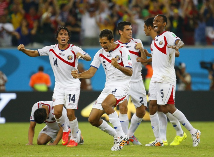 Costa Rica's players celebrate winning their 2014 World Cup round of 16 game against Greece at the Pernambuco arena in Recife June 29, 2014. (Brian Snyder/Reuters)