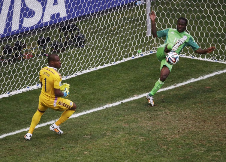Nigeria's Victor Moses (R) clears a shot by France's Karim Benzema (not pictured) off the goal line, as Nigeria's goalkeeper Vincent Enyeama watches, during their 2014 World Cup round of 16 game at the Brasilia national stadium in Brasilia June 30, 2014. (David Gray/Reuters)