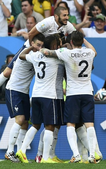 France's Paul Pogba is surrounded by his teammates as they celebrate his goal against Nigeria during their 2014 World Cup round of 16 game at the Brasilia national stadium in Brasilia June 30, 2014. Pictured are Laurent Koscielny (L), Patrice Evra (C), Mathieu Debuchy and Karim Benzema (top). (Dylan Martinez/Reuters)