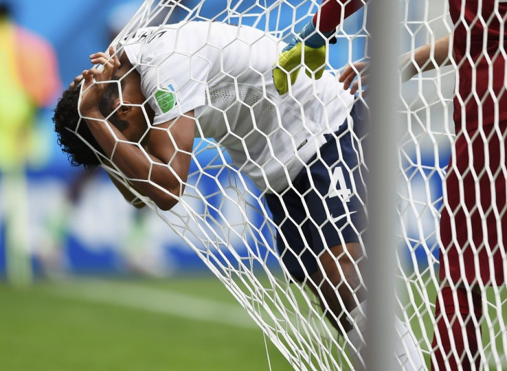 France's Raphael Varane reacts against the goal net to getting hit in the face by the ball during their 2014 World Cup round of 16 game against Nigeria at the Brasilia national stadium in Brasilia June 30, 2014. (Dylan Martinez/Reuters)