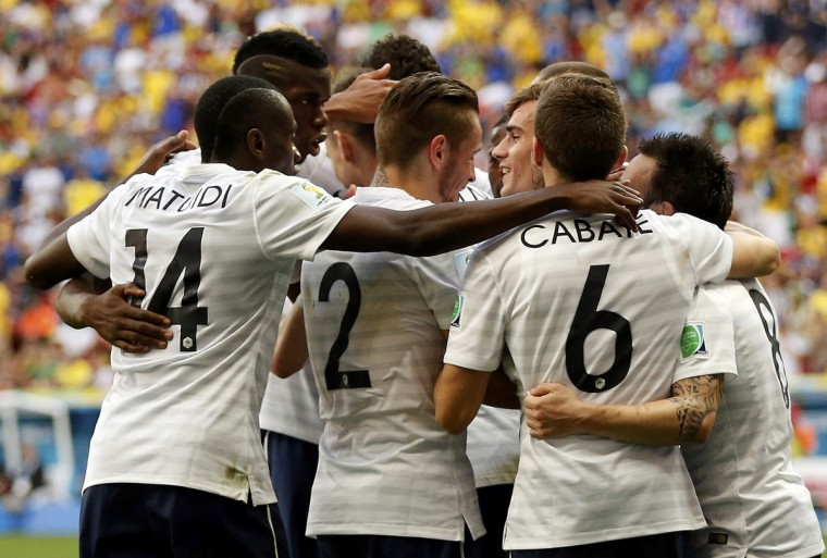 France's players celebrate after Nigeria's Joseph Yobo scored his own goal during their 2014 World Cup round of 16 game at the Brasilia national stadium in Brasilia June 30, 2014. (Siphiwe Sibeko/Reuters)