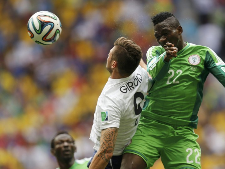 France's Olivier Giroud (L) fights for the ball with Nigeria's Kenneth Omeruo during their 2014 World Cup round of 16 game at the Brasilia national stadium in Brasilia June 30, 2014. (Ueslei Marcelino/Reuters)