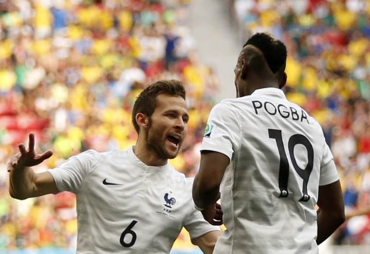France's Paul Pogba celebrates his goal with team mate Yohan Cabaye (L) during their 2014 World Cup round of 16 game against Nigeria at the Brasilia national stadium in Brasilia June 30, 2014. (Siphiwe Sibeko/Reuters)