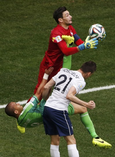 France's goalkeeper Hugo Lloris (top) makes a save near teammate Laurent Koscielny (21) and Nigeria's Peter Odemwingie during their 2014 World Cup round of 16 game at the Brasilia national stadium in Brasilia June 30, 2014. (David Gray/Reuters)