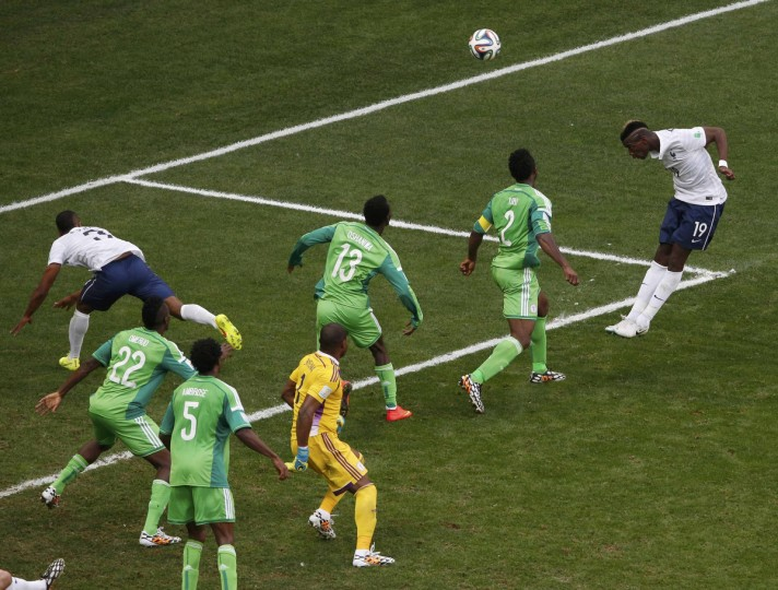 France's Paul Pogba (19) heads to score a goal against Nigeria during their 2014 World Cup round of 16 game at the Brasilia national stadium in Brasilia June 30, 2014. (David Gray/Reuters)